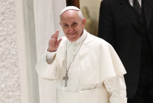 Pope Francis arrives to lead a special audience with students of Jesuit schools at the Vatican
